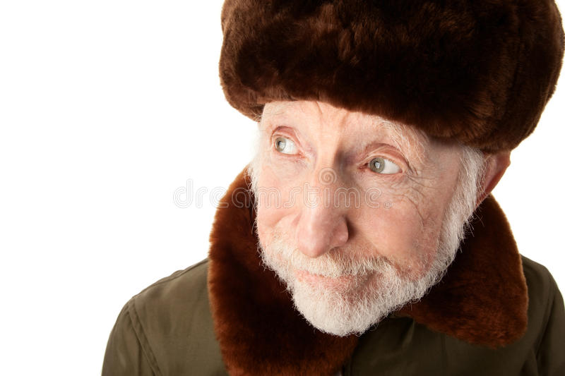 Russian Man in Fur Cap. Senior Russian Man in Fur Cap and jacket royalty free stock photo