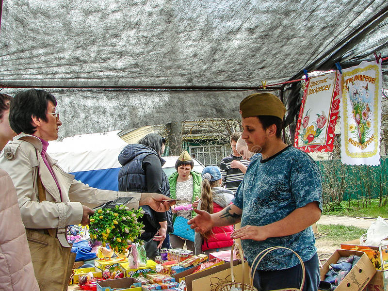 On the Russian market in the Kaluga region. In Russia open-air markets in the open air are very popular and in demand among buyers. Here the people sell a stock images