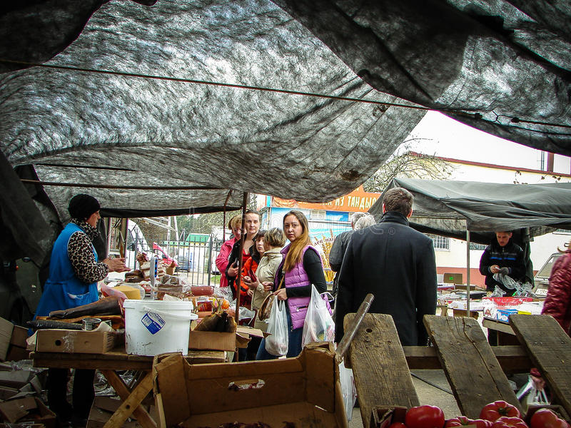 On the Russian market in the Kaluga region. In Russia open-air markets in the open air are very popular and in demand among buyers. Here the people sell a royalty free stock image