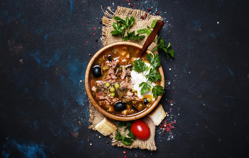 Russian Meat Solyanka Soup In Wooden Bowl, Top View royalty free stock photography