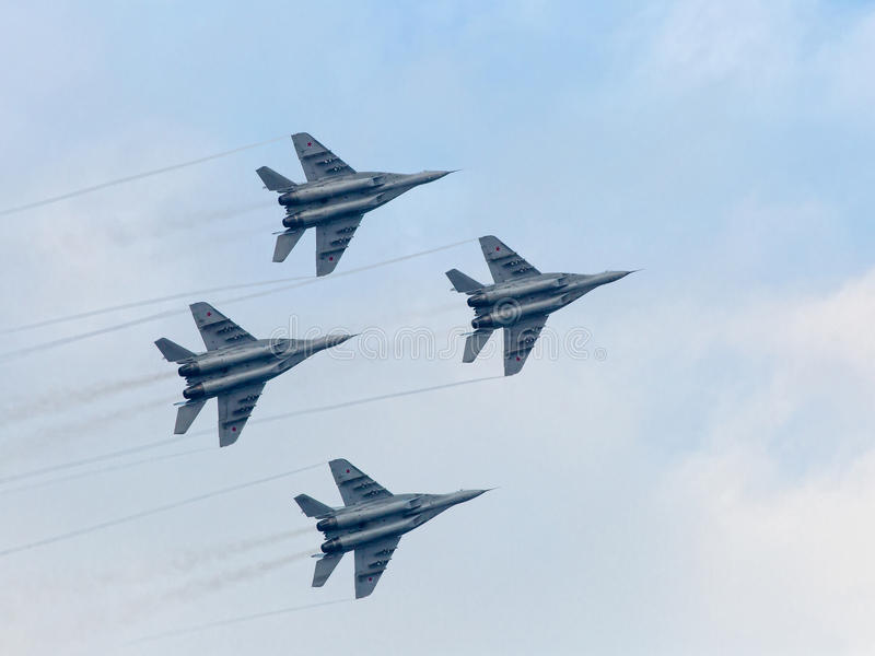 Russian military jet planes in sky. Four war jet planes in sky. Russian military jet planes showing aerobatics stock photography