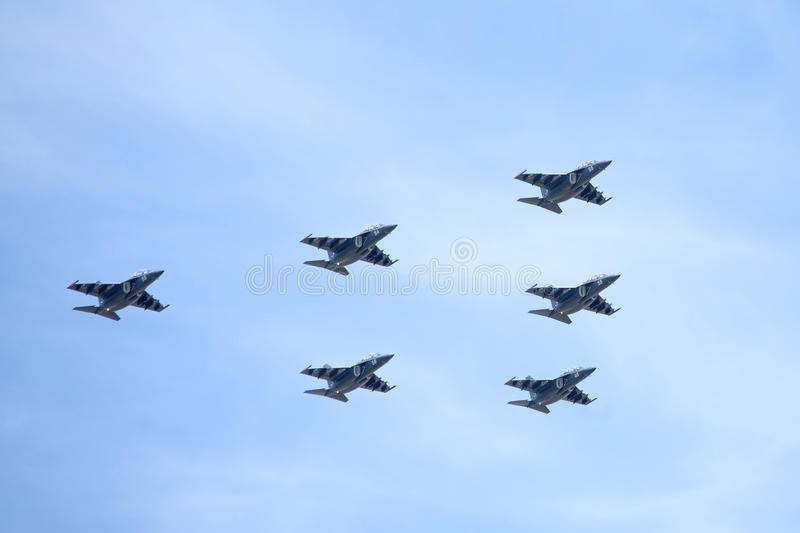 Russian military planes SU-25 UTG (Rook) in flight. Six Russian military trainer subsonic attack planes SU-25 UTG (Rook) in flight against the blue sky stock photography