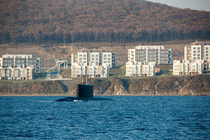 Russian military submarine pops up near the residential buildings of a large city royalty free stock image