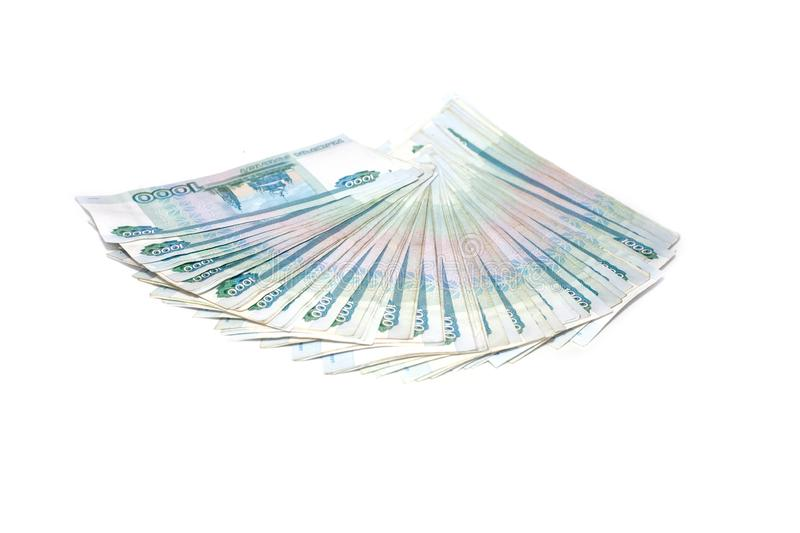 Russian money banknotes rouble on white background. in nominal value of one thousand. Close up Rich concept. Russian money banknotes currency rouble on white stock photo