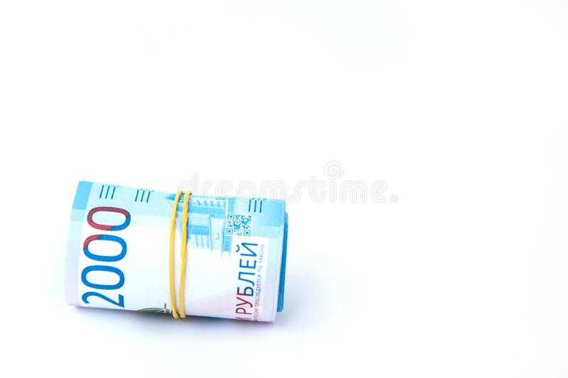 Russian money banknotes currency rouble on white isolated background. in nominal value of two thousand. Close up. Rich concept. Russian money banknotes currency royalty free stock images