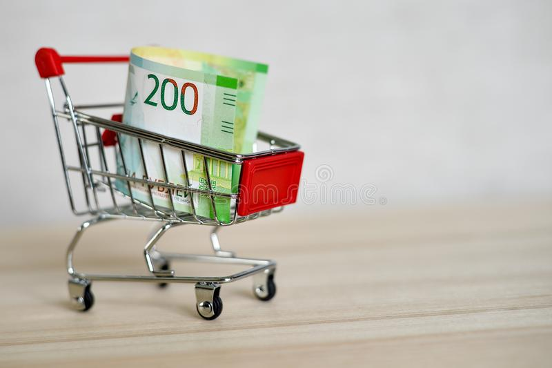 Russian money banknotes in a shopping trolley, online shopping concept royalty free stock images