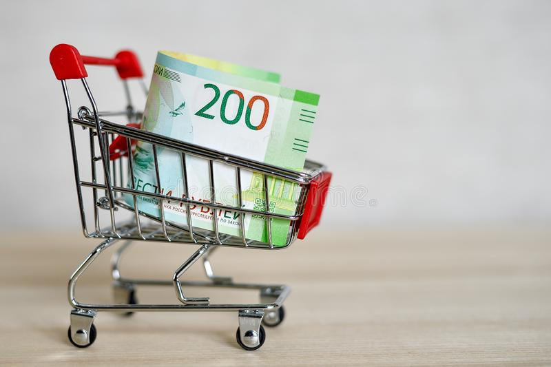 Russian money banknotes in a shopping trolley, online shopping concept royalty free stock image