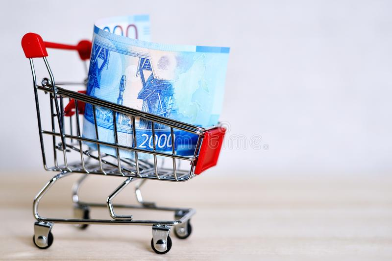 Russian money banknotes in a shopping trolley, online shopping concept stock photography