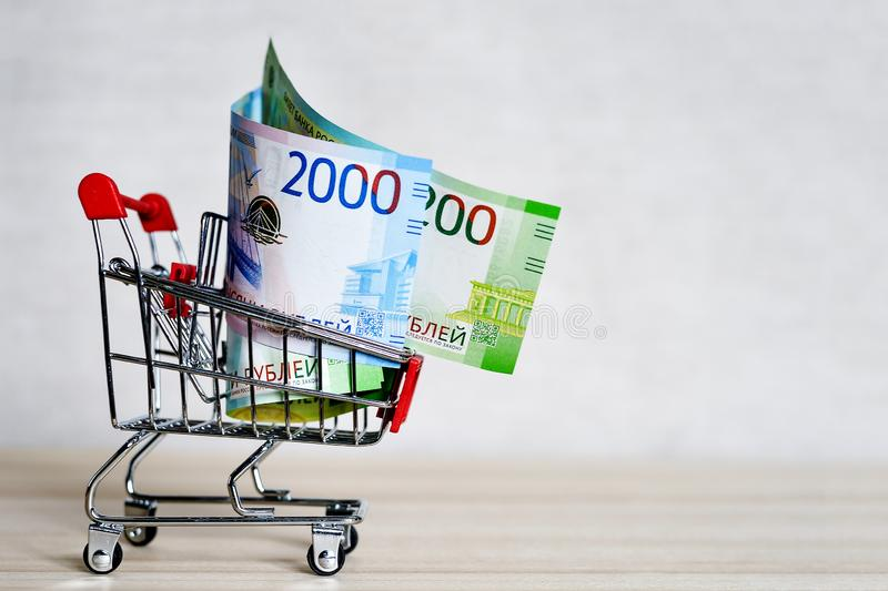Russian money banknotes in a shopping trolley, online shopping concept.  royalty free stock photography