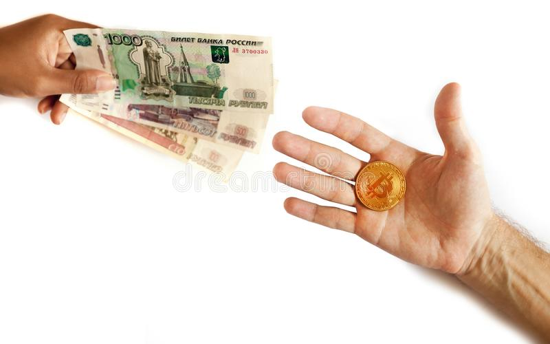 Russian money and bitcoin in the hand of people. Exchange, sale and purchase the Russian ruble and the new world international crypto currency btc bit coin on royalty free stock photos
