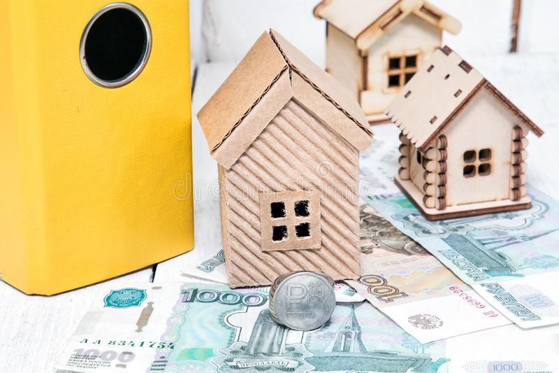 Russian money and different houses. Ruble mortgage. Russia royalty free stock photos