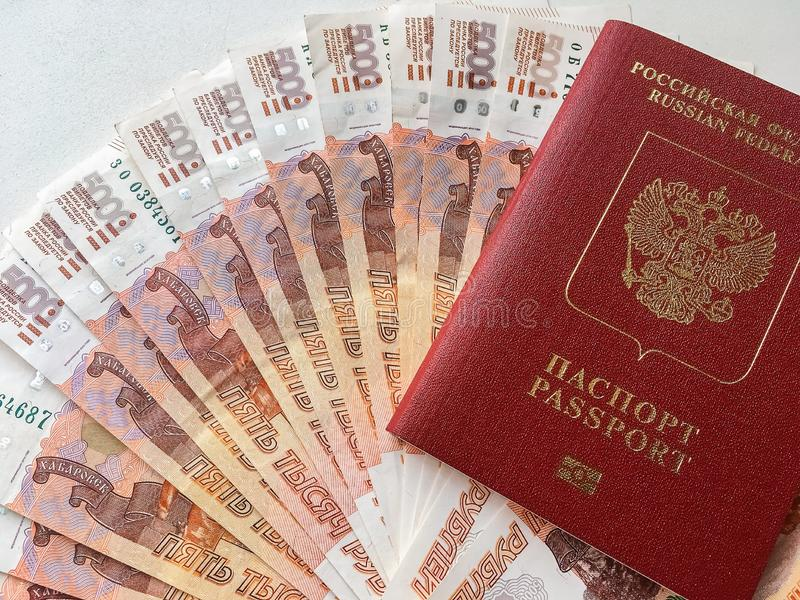 Russian money and passport on a gray background, close-up. Soft focus royalty free stock photography