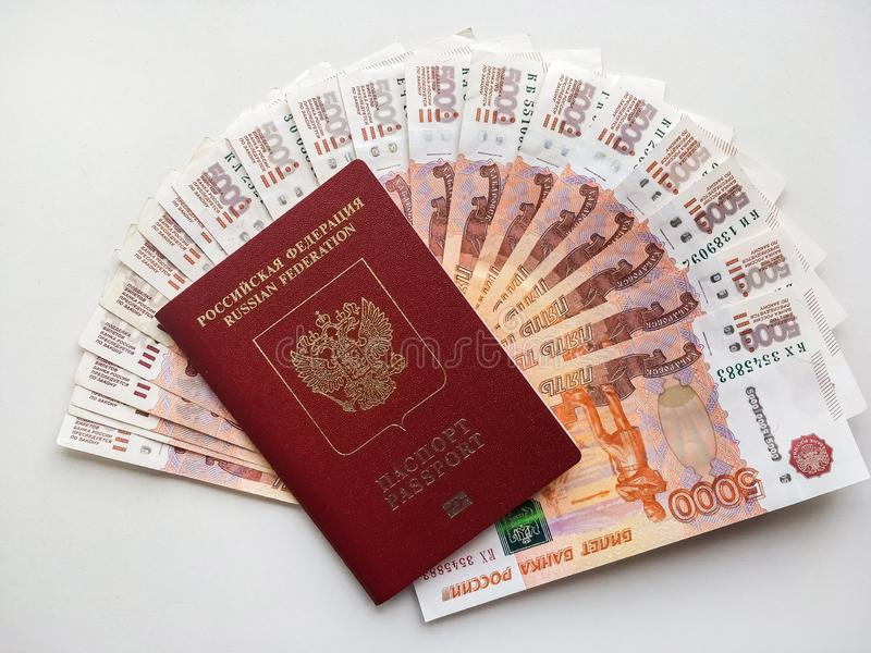 Russian money and passport on a gray background, close-up. Soft focus stock photography