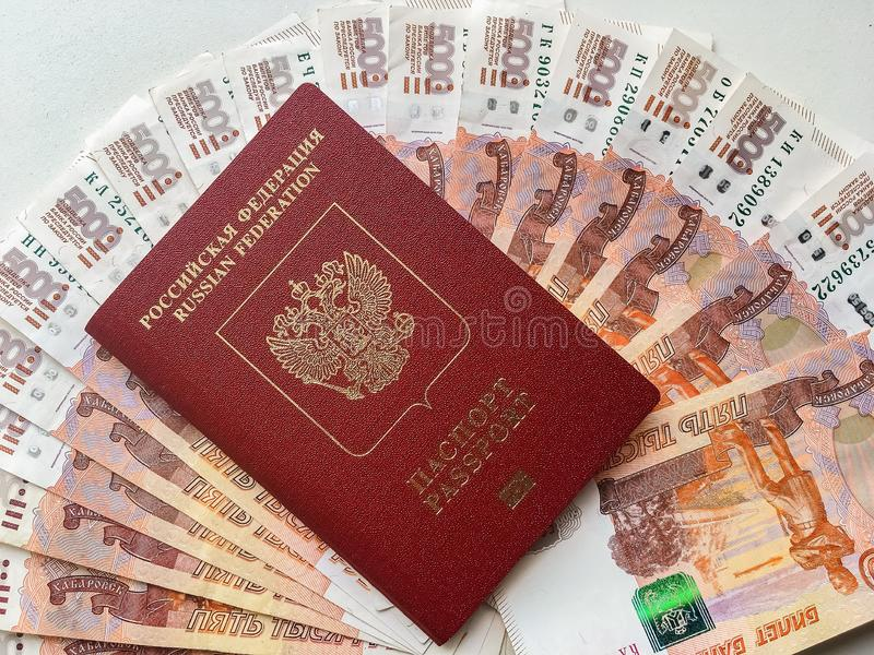 Russian money and passport on a gray background, close-up. Soft focus royalty free stock photos
