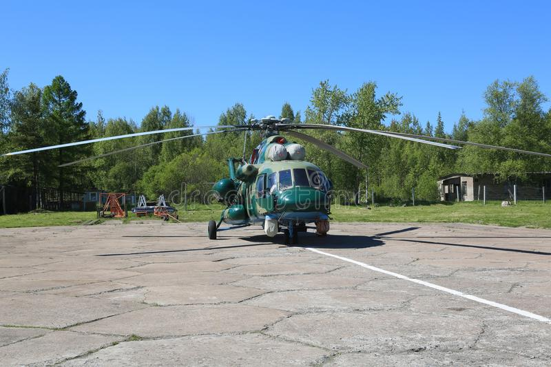 Russian multipurpose helicopter Mi-8 on the airfield on a sunny day stock photography