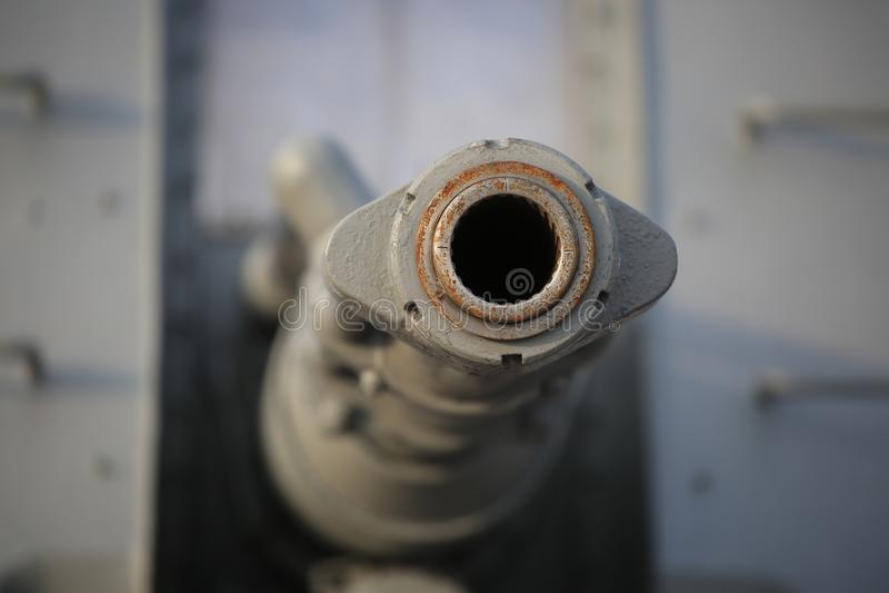 AK-176 dual purpose main naval gun. Front view of the muzzle closeup stock image