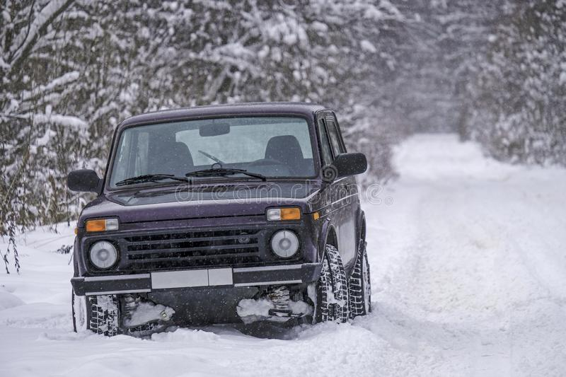 Russian off-road car Lada Niva on a snowy road stock images