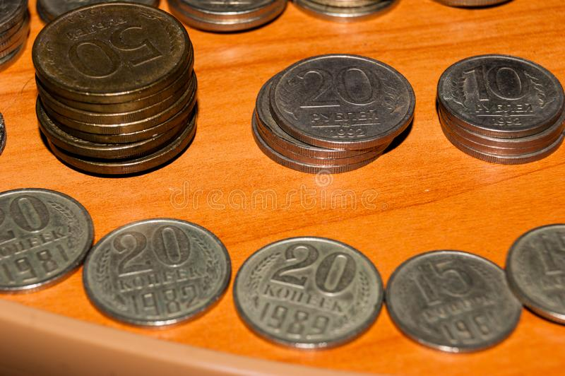 Russian old coins stacked on the table. Russian ancient coins stacked on the table royalty free stock photo