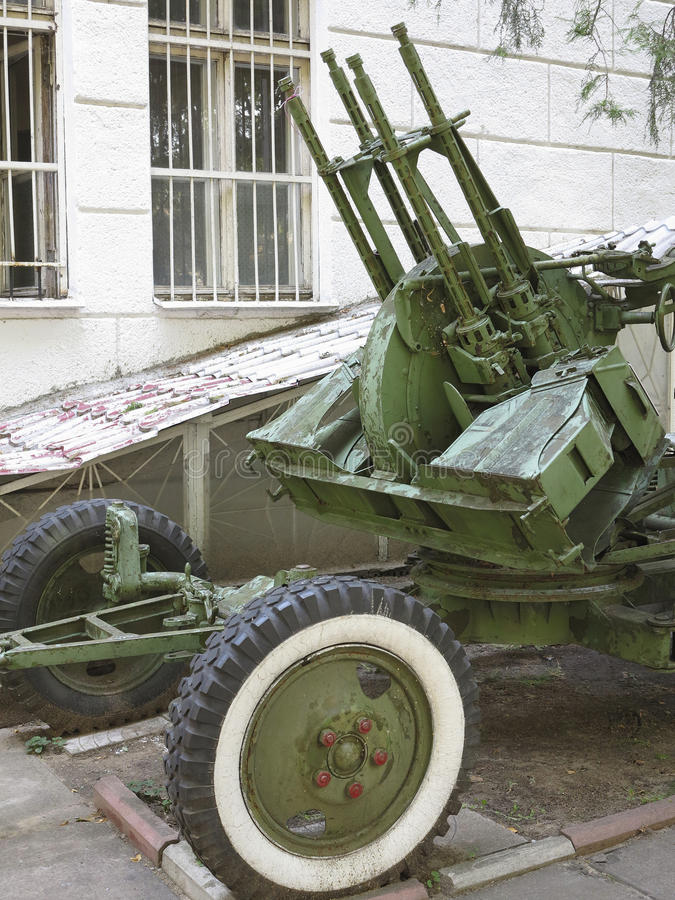 Russian old green anti-aircraft gun isolated over white. Background stock photo