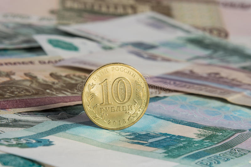 On Russian paper banknotes standing on the edge of Russian ten-coin stock photo