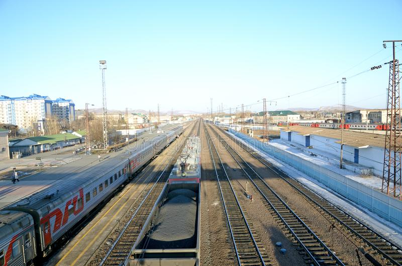 Russian passenger and freight train at the railway station. royalty free stock photo