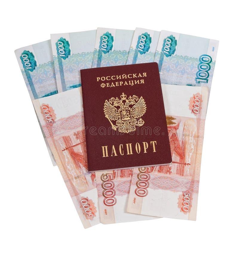 Russian passport. On the batch of bills stock photos
