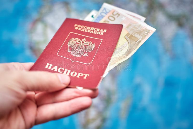 Russian passport and Euro banknotes on the map background stock image