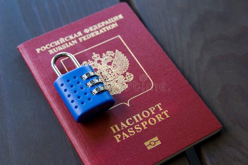 Russian passport locked to padlock. Symbol of anti-Russian sanctions.  royalty free stock images