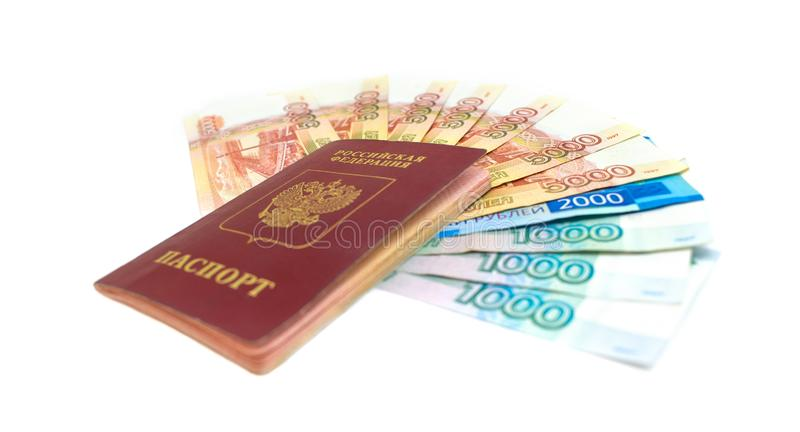 Russian passport with money isolated on white background. Russian rouble banknote cash. Soft focus royalty free stock photography