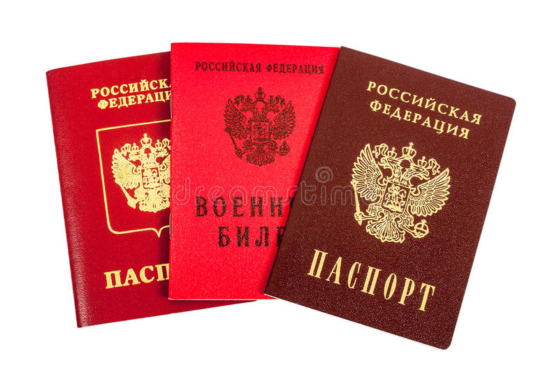 Russian passports and Military ID. Russian passports (national and international type) and Military ID royalty free stock photo