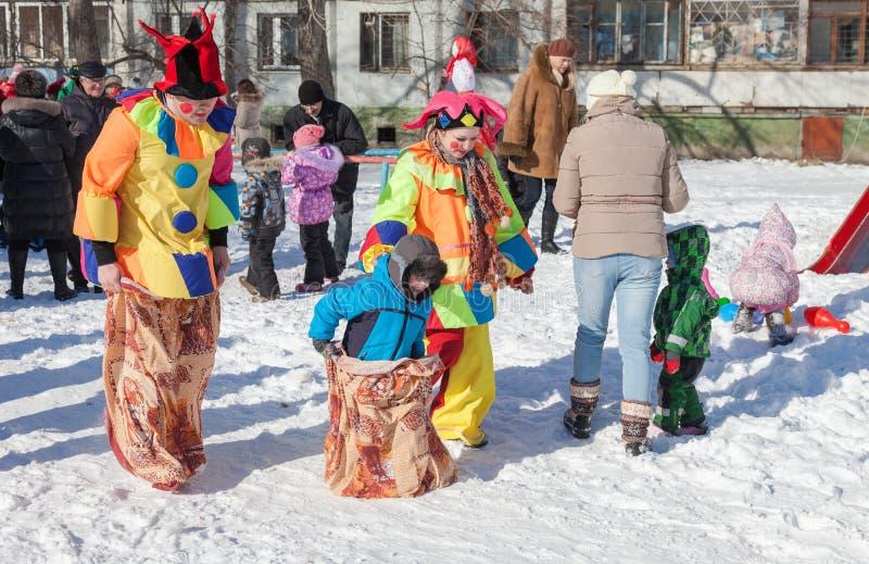 Russian people celebrates Shrovetide. RUSSIA, SAMARA - FEBRUARY 20, 2015: Russian people celebrates Shrovetide. Maslenitsa or Pancake Week is the Slavic Holiday stock photo