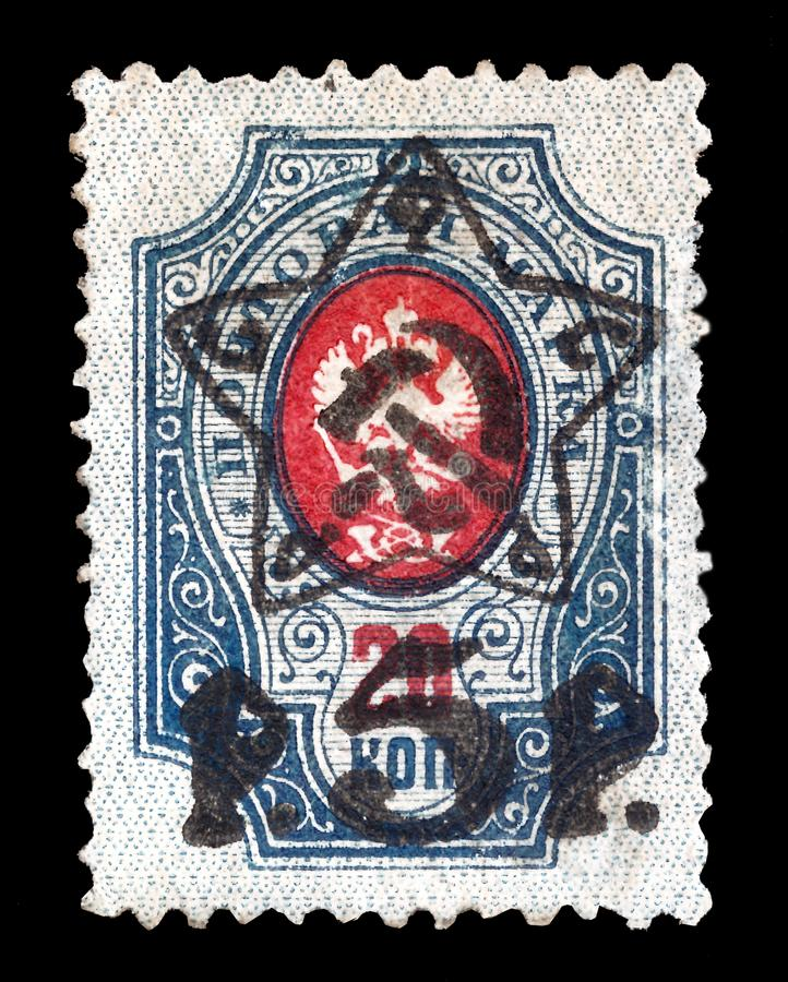 Russian Postage Stamp issued in Tsarist Russia before the Revolution of 1917 and used in Bolshevik Russia by means of overprints stock photos
