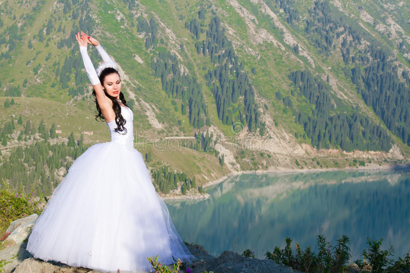 Russian pretty woman bride in her wedding dress stock image