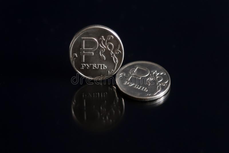 Russian ruble coins on a black mirroring surface. Conceptual photo stock photography