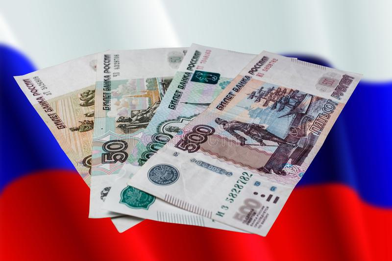 Russian rubles on a colored background. Banknotes of Russian money royalty free stock images