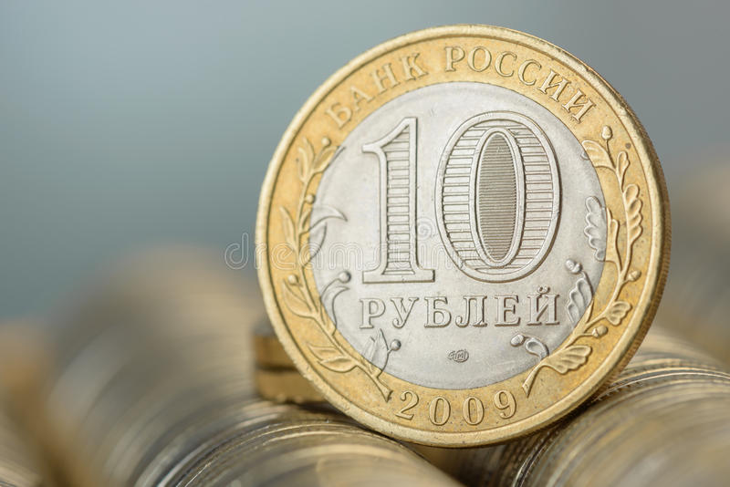 10 Russian rubles stack of metal gold coins background. Money stock photography