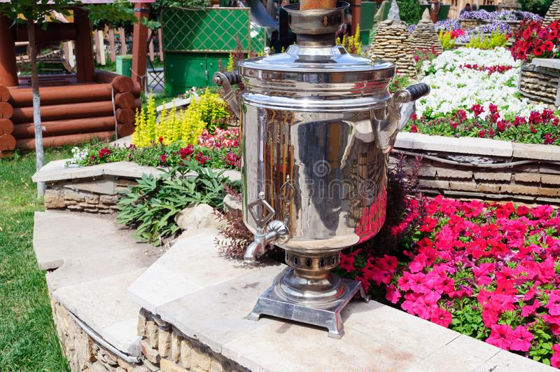 Russian samovar for tea in the garden stock images