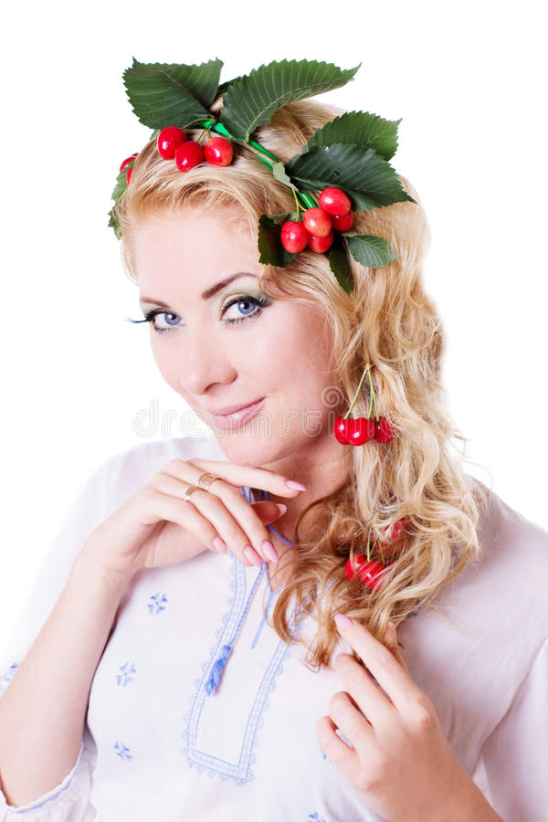 Russian sensual woman with wreath from cherry and leaves stock image