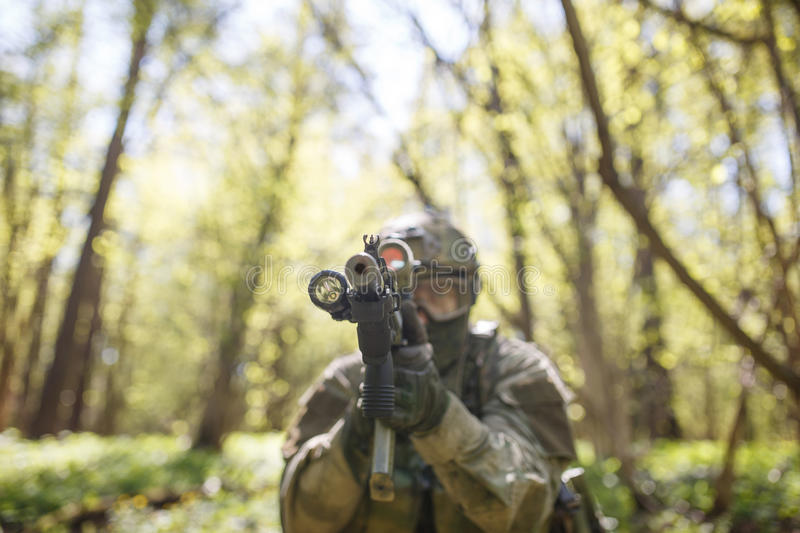 Russian soldier aiming in woods stock image