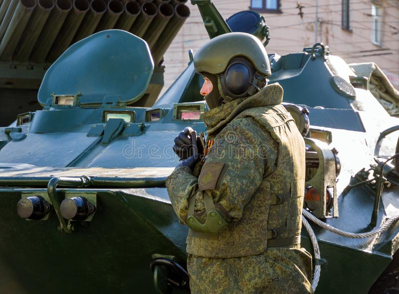 Russian soldier in modern outfit stands at military equipment royalty free stock photos