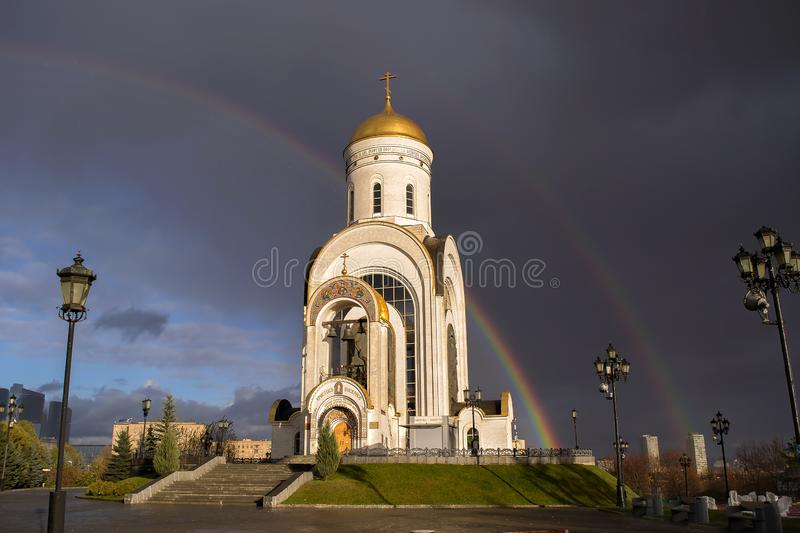 Russian spiritual and religious architectural tradition Christian Church landmark On background of rainbow and the. Christian Church temple is the Cathedral in royalty free stock photos