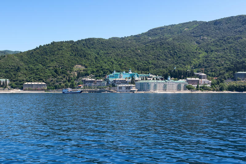 Russian St. Panteleimon`s Orthodox monastery on the Mount Athos, Holy Mountain, Halkidiki, Greece. View from the sea. stock photos