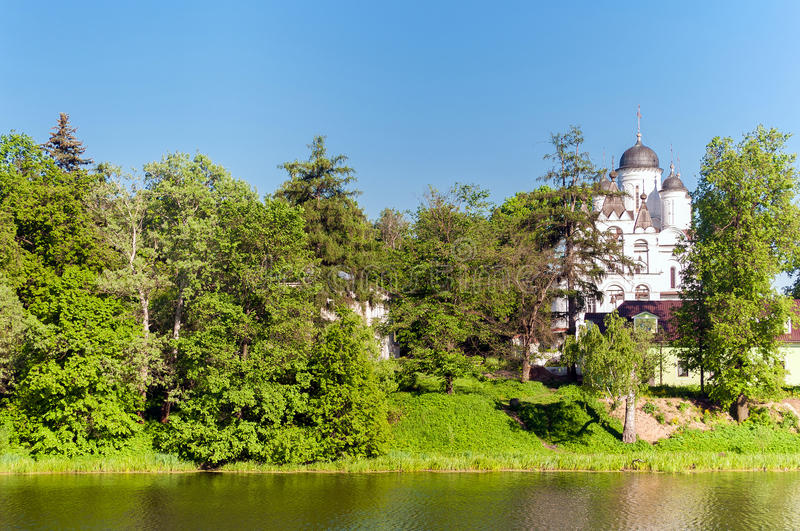 Russian summer landscape with white chuch. Trees and river royalty free stock photography