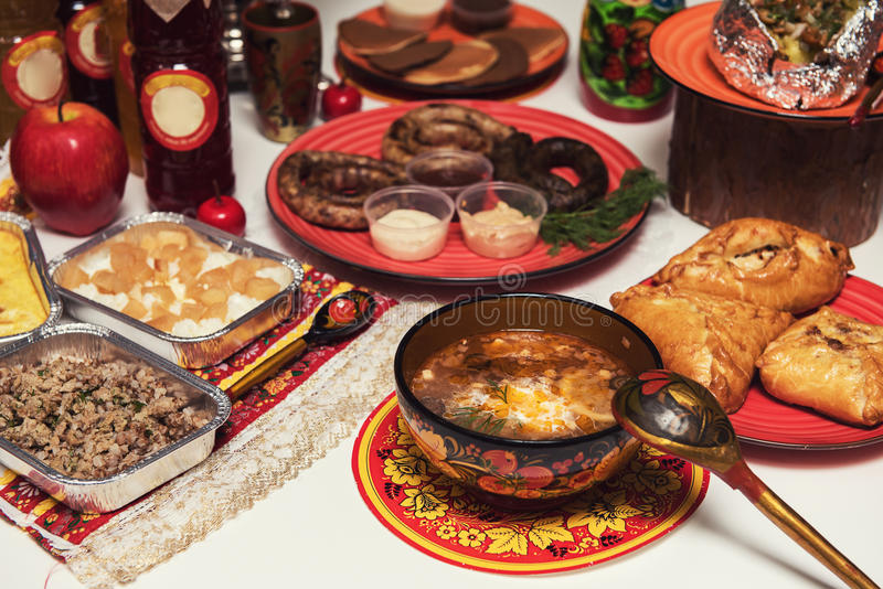 Russian table with food. Table with traditional russian food decorated in russian style stock image