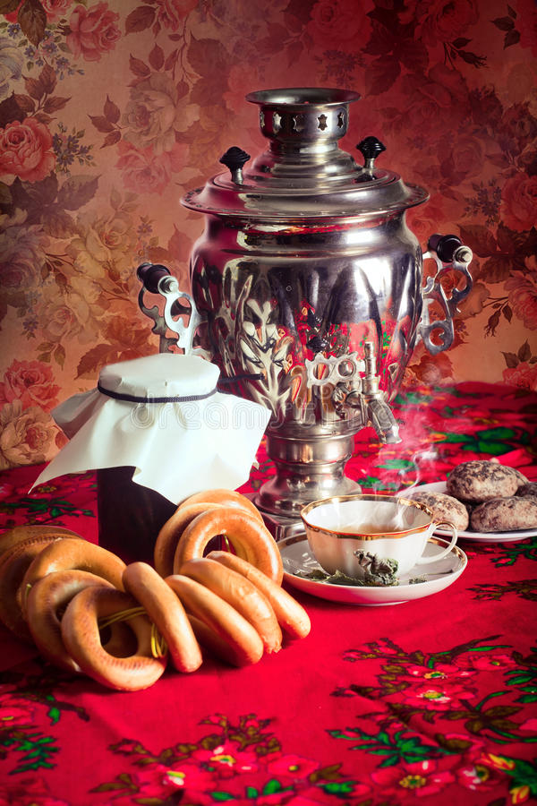 Russian tea. Traditional Russian tea from Samovar with cakes, bagels and raspberry jam