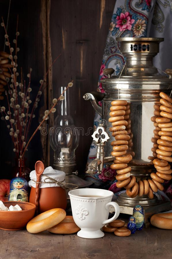 Russian Tea Party including black tea from samovar, lump sugar, bagels sushki and baranki royalty free stock images