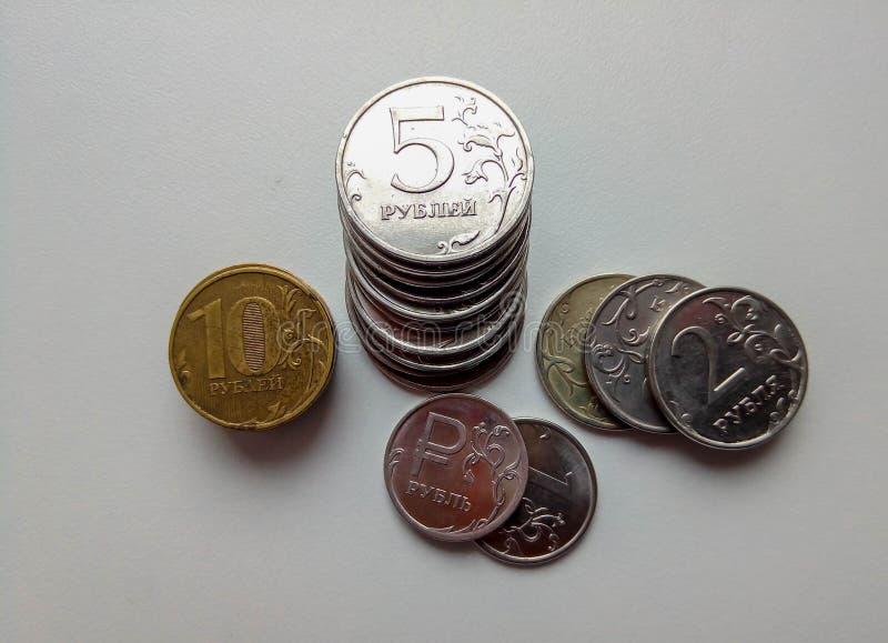Russian ten ruble coins on white background. Economy finanse money royalty free stock photos