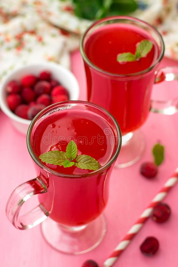Russian traditional drink kissel with cranberries and mint stock photo