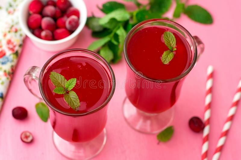 Russian traditional drink kissel with cranberries and mint stock image
