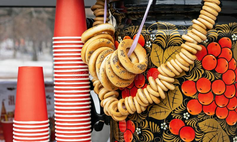 Russian traditional samovar with bundles of bagels stock images